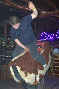 Photo: Man riding mechanical bull