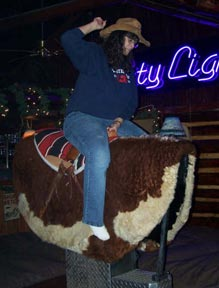 Photo: Woman riding mechanical bull