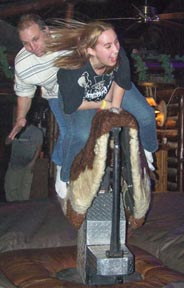 Photo: 2 people riding mechanical bull