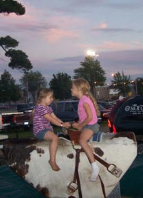 Photo sun setting mechanical bull riders