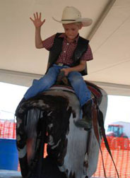 Photo bucking mechanical bull riding